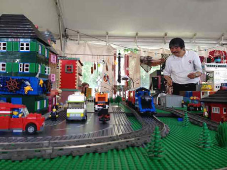 Tak looking at Lego railroad set